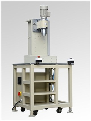 Radial spin riveting machine